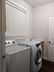 small laundry room front wall